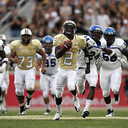 Central Florida quarterback Jeff Godfrey (2) outruns everyone during an NCAA football game between the Memphis Tigers and the Central Florida Knights at Bright House Networks Stadium on Saturday, October 29, 2011 in Orlando, Florida. (AP Photo/Alex Menendez)
