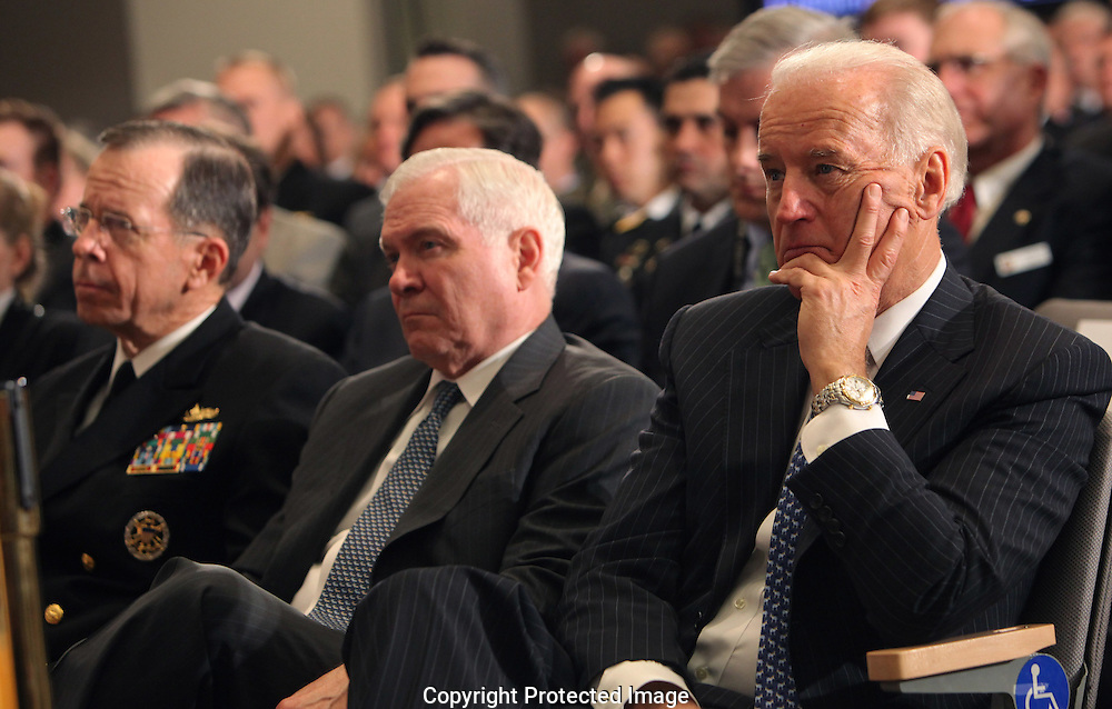 Chairman of the Joint Chiefs of Staff Mike Mullen, Secretary of Defense Robert Gates and Vice President Joseph Biden watch President Barack Obama update the American people on the situation in Libya. President Obama is speaking at the National Defense University in Washington, DC on March 28, 2011. photo by Dennis Brack