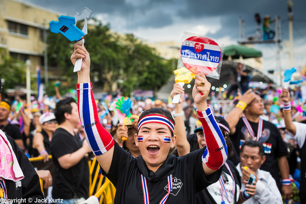 """15 NOVEMBER 2013 - BANGKOK, THAILAND: People cheer anti-government speakers during a protest rally in Bangkok. Tens of thousands of Thais packed the area around Democracy Monument in the old part of Bangkok Friday night to protest against efforts by the ruling Pheu Thai party to pass an amnesty bill that could lead to the return of former Prime Minister Thaksin Shinawatra. Protest leader and former Deputy Prime Minister Suthep Thaugsuban announced an all-out drive to eradicate the """"Thaksin regime."""" The protest Friday was the biggest since the amnesty bill issue percolated back into the public consciousness. The anti-government protesters have vowed to continue their protests even though the Thai Senate voted down the bill, thus killing it for at least six months.     PHOTO BY JACK KURTZ"""
