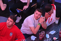 © Licensed to London News Pictures. 11/07/2021. London, UK. England supporters react at Boxpark in Croydon, south London as they watch the EURO 2020 final between England and Italy on a giant TV screen. Photo credit: Ray Tang/LNP