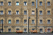 The cell windows of D wing from the exercise yard at Wandsworth Prison. HM Prison Wandsworth is a Category B men's prison at Wandsworth in the London Borough of Wandsworth, South West London, United Kingdom. It is operated by Her Majesty's Prison Service and is one of the largest prisons in the UK with a population over 1500 people. (photo by Andy Aitchison)