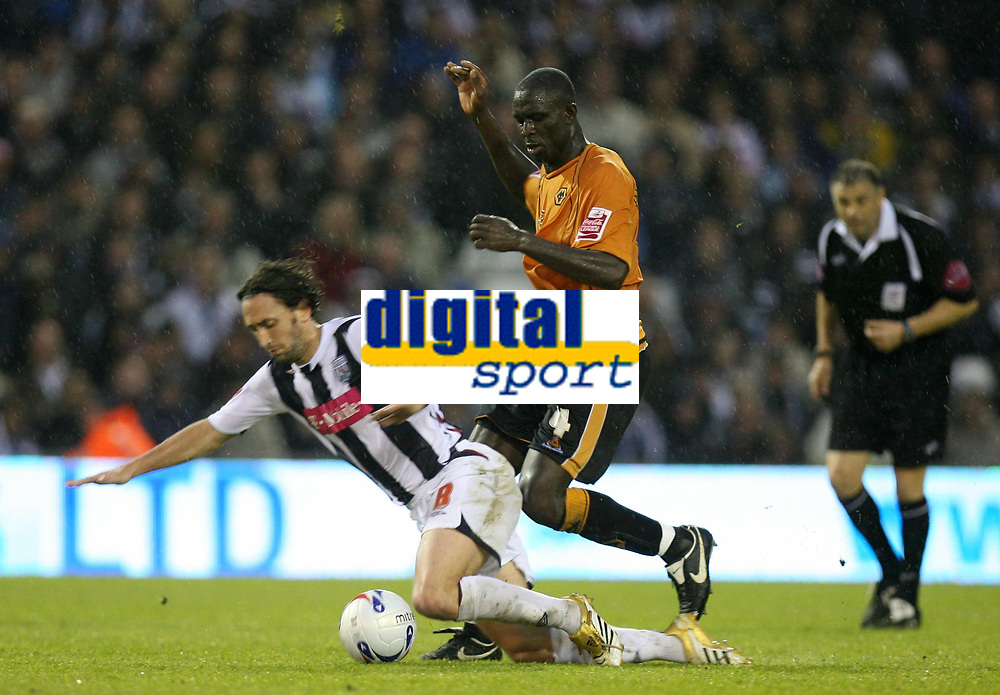 Photo: Rich Eaton.<br /> <br /> West Bromwich Albion v Wolverhampton Wanderers. Coca Cola Championship. Play off Semi Final 2nd Leg. 16/05/2007. West Broms Jonathan Greening is bought down by Seyi Olofinjana