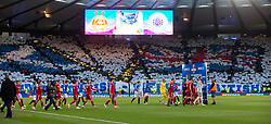 Players walk out for the Betfred Cup semi final match at Hampden Park, Glasgow.
