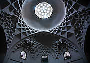 Stunning photographs reveal the beautiful ceilings in Iran's mosques, bazaars and public baths<br /> <br /> For the past few decades, restrictions on travel to Iran has meant the country has been largely shut off from the Western world, butas visa sanctions are lifted in the light of a landmark nuclear deal, the local tourism industry is hoping for a flurry of visitors.<br /> It's not hard to see why Iran is listed as one of the top travel destinations of 2016, with its rich culture and history.<br /> Among the standout aspects of the nation is its beautiful ancient architecture, with the cities and towns littered withornate and eye-catching mosques, public baths and markets.<br /> And unlike many other countries - the roof is not an afterthought, with many ceilings built as the centrepiece to the building, with many of the tile designs showcasing a display of intricate geometric patternsthatdate back several centuries.<br /> French photographerEric Lafforgue has travelled the country photographing the ceilings of indoor markets, mosques and bath houses.<br /> <br /> Photo shows: ceiling with its intricate and elaborate patterns in ganjali khan hammam, Central County, Kerman, Iran