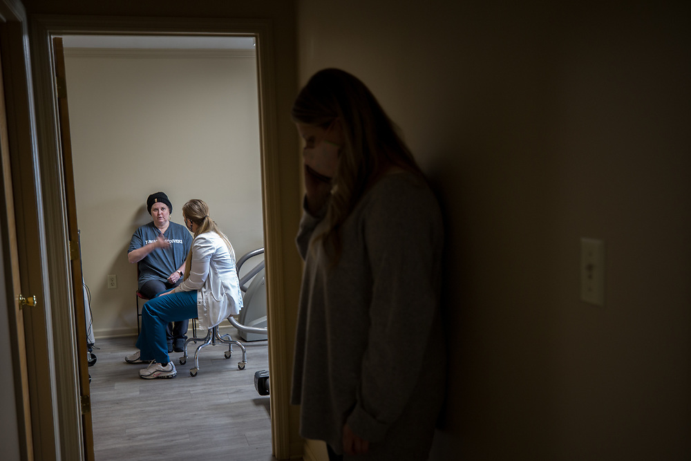 ALMA, GA - MARCH 30, 2021: Martin's daughter Harper Lee stands in the hallway outside her treatment room giving family members updates on her cell phone. (AJC Photo/Stephen B. Morton)