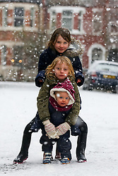 © Licensed to London News Pictures. 24/01/2021. London, UK. Annie 8 years old, Rose 6 year old and Clara 1 year old in the the snow with their dad in north London as large parts of the UK are expected to be blanketed in snow and freezing conditions. According to the Met Office, the cold weather could bring up to 10cm of snow to some parts of the country and an amber weather warning for snow and ice is in place across much of the UK. <br /> <br /> ***Permission Granted***<br /> <br /> Photo credit: Dinendra Haria/LNP