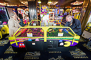 EMBARGOED 00:01 Wednesday 22nd February; 2017.<br /> <br /> Residents from Chestnut View care home playing air hockey in the seafront arcade while visiting Southsea, Hampshire. They are amongst the first of 100,000s of old and vulnerable people to enjoy new Out and About excursions after Oomph! announces nationwide expansion plans today (Wednesday 22nd February).<br /> Out and About tackles a lack of outings for people in care settings due to social care funding cuts. Innovative model offers economies of scale on excursion planning, transport and conductors across care settings in an area.<br /> 80 Out and About minibuses will hit the road in first year thanks to £1.5million investment from Mike Parsons, Care and Wellbeing Fund and Nesta Impact Investments.<br /> Photograph by Christopher Ison ©<br /> 07544044177<br /> chris@christopherison.com<br /> www.christopherison.com
