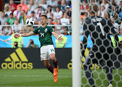 June 27, 2018 - Yekaterinburg, Russia - Javier Hernandez (L) of Mexico controls the ball during the 2018 FIFA World Cup Group F match between Mexico and Sweden in Yekaterinburg, Russia, June 27, 2018. Sweden won 3-0. Mexico and Sweden advanced to the round of 16. (Credit Image: © Li Ming/Xinhua via ZUMA Wire)