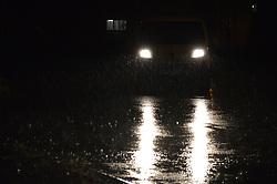 June 19, 2017 - Ankara, Turkey - A car drives on the road during heavy rain in summer in Ankara, Turkey on June 19, 2017. (Credit Image: © Altan Gocher/NurPhoto via ZUMA Press)