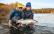 Kate Taylor and Kelli Dotson land a bright silver rainbow on the Naknek River in Alaska.