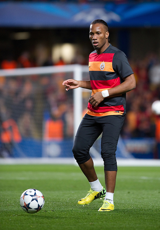 Galatasaray's Didier Drogba during the pre-match warm-up <br /> <br /> Photo by Ashley Western/CameraSport<br /> <br /> Football - UEFA Champions League First Knockout Round 2nd Leg - Chelsea v Galatasaray - Tuesday 18th March 2014 - Stamford Bridge - London<br />  <br /> © CameraSport - 43 Linden Ave. Countesthorpe. Leicester. England. LE8 5PG - Tel: +44 (0) 116 277 4147 - admin@camerasport.com - www.camerasport.com