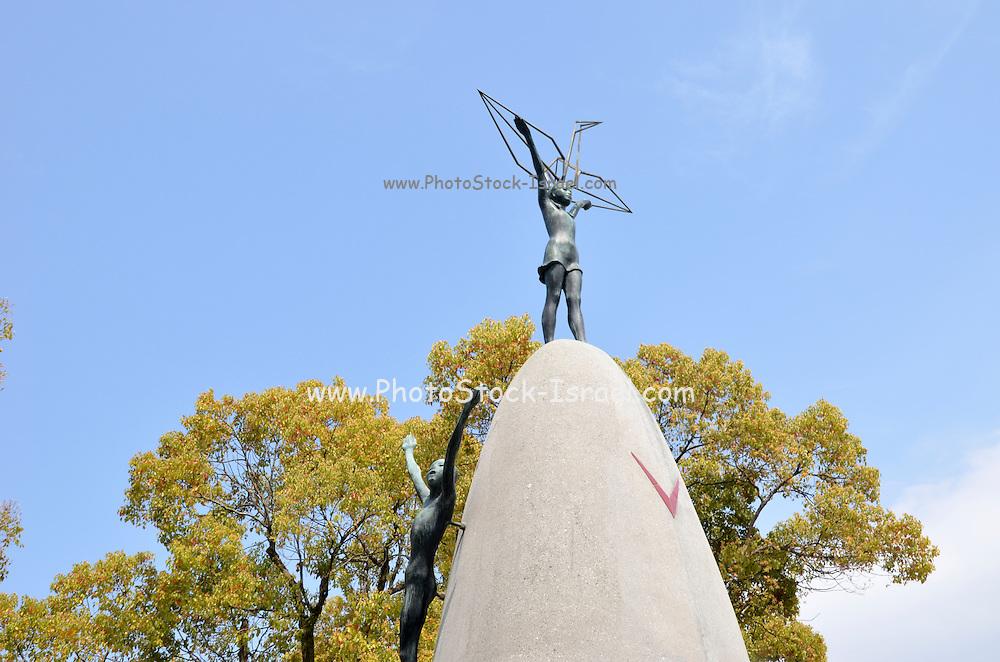 Japan, Honshu, Hiroshima, Peace Memorial Park for atomic bomb of 6 august 1945 Children's Peace Monument statue of Sasaki Sadako holding a crane