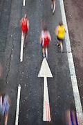 Runners in the 2010 Virgin London Marathon. Upper Thames Street.