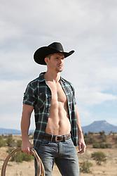 hot cowboy with an open shirt outdoors