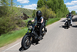 Jodi Kunz, a graduate student in Salt Lake City, UT on her 2013 48 Sportster riding from Steamboat Springs to Doc Holliday's Harley-Davidson in Glenwood Springs during the Rocky Mountain Regional HOG Rally, Colorado, USA. Thursday June 8, 2017. Photography ©2017 Michael Lichter.