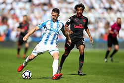 Huddersfield Town's Jonathan Hogg (left) and Arsenal's Alex Iwobi battle for the ball