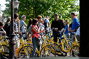 Amsterdam - Netherlands . Rent a bike and cycle with a guide through Amsterdam. A group is standing still on the Prinsengracht with a vieuw on the House of Anne Frank.