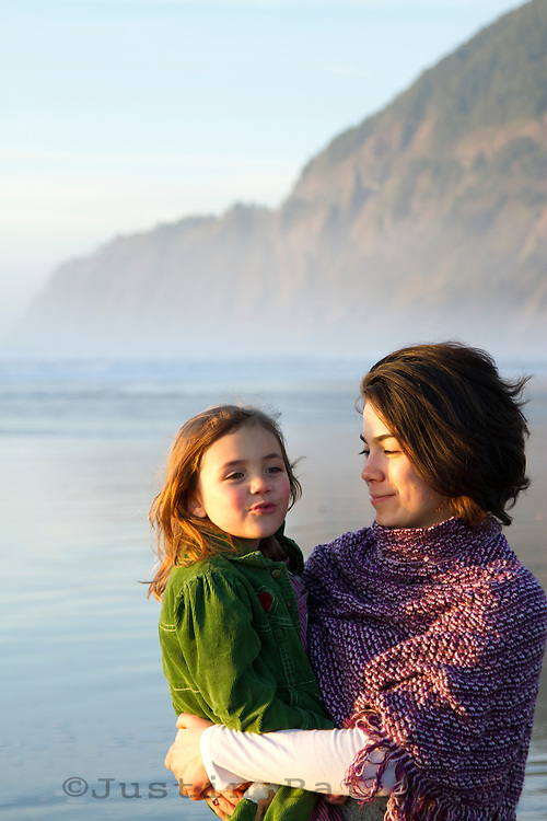 Mother and daughter playing on the beach.