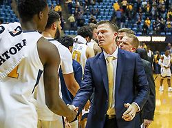 Nov 24, 2018; Morgantown, WV, USA; Valparaiso Crusaders head coach Matt Lottich talks with West Virginia Mountaineers players after the game at WVU Coliseum. Mandatory Credit: Ben Queen-USA TODAY Sports