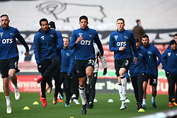 Derby County players warm up prior to the match