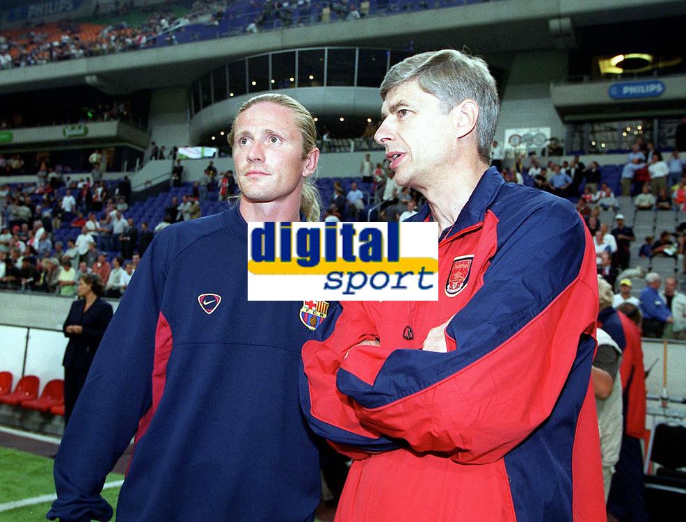 Arsene Wenger the Arsenal Manager talks to Emmanuel Petit (Barcelona) before the game. Arsenal v FC Barcelona, The Amsterdam Tournament, Amsterdam Arena, Holland, 3/8/2000. Credit Colorsport / Stuart MacFarlane.