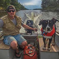 Ben Wiltsie boats across Lake of the Woods with his dog, Evie.