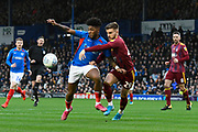 Ellis Harrison (22) of Portsmouth battles for possession with Luke Garbutt (29) of Ipswich Town during the EFL Sky Bet League 1 match between Portsmouth and Ipswich Town at Fratton Park, Portsmouth, England on 21 December 2019.