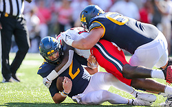 Sep 4, 2021; College Park, Maryland, USA; West Virginia Mountaineers quarterback Jarret Doege (2) is sacked by Maryland Terrapins linebacker Deshawn Holt (39) during the first quarter at Capital One Field at Maryland Stadium. Mandatory Credit: Ben Queen-USA TODAY Sports