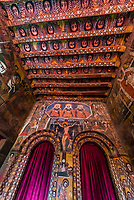 Interior of Birhan Silassie Church, Gondar, Ethiopia. Built in the 17th century.<br /> The walls depict biblical scenes and saints and the ceiling is covered with the faces of hundreds of angels. Icons of the Holy Trinity (three identical men with halos) and the Crucifixion have pride of place above the entrance to the Holy of Holies.