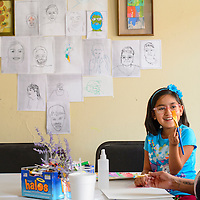 071614  Adron Gardner/Independent<br /> <br /> Isabella Shirley, 8, brandishes a paint brush to Nitasha Manning during an art party at the Expressive Arts Studio in Gallup Wednesday.