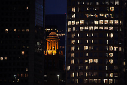 Downtown Houston, Texas cityscape with Niels-Esperson Building Cupola lit at night.