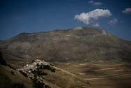 Castelluccio di Norcia, the famous Piana (valley) and the Redentore mountain. After the earthquake the village and the surrounding areas collapsed for about 70 centimeters. On the mountain a crack is visible