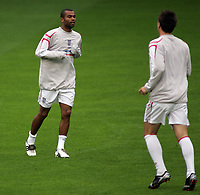 Photo: Paul Thomas.<br /> England training at Carrington. 30/08/2006. <br /> <br /> Ashley Cole (L) runs up to  John Terry.