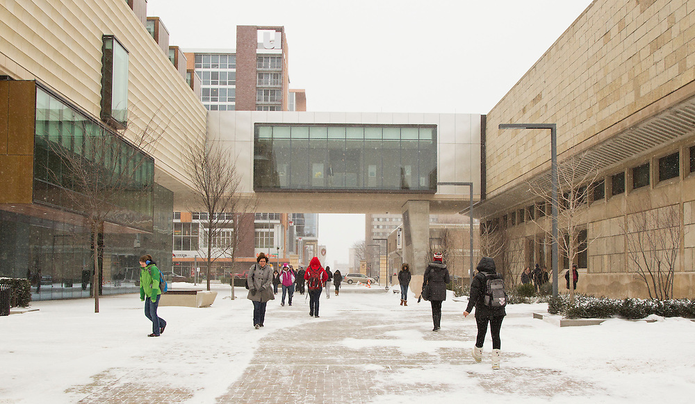 Pedestrians make their way along the East Campus Mall at the University of Wisconsin-Madison, passing the newly completed addition to the Chazen Museum of Art, in Madison, Wis., Feb. 10, 2012. (Photo © Andy Manis)