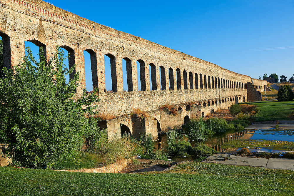 Los Milagros Aquaduct of the Roman colony of Emerita Augusta (Mérida) dedicated by the consul Marcus Vipsanius Agrippa and built in 15BC, renovated late 1st Century AD, Merida, Estremadura, Spain . Emerita Augusta (Merida)  was founded as a Roman colony in 25 BC under the order of the emperor Augustus to serve as a retreat for the veteran soldiers (emeritus) of the legions V Alaudae and X Gemina. The city, one of the most important in Roman Hispania, The archeological site in the city has been a UNESCO World Heritage site since 1993.<br /> <br /> Visit our SPAIN HISTORIC PLACES PHOTO COLLECTIONS for more photos to download or buy as wall art prints https://funkystock.photoshelter.com/gallery-collection/Pictures-Images-of-Spain-Spanish-Historical-Archaeology-Sites-Museum-Antiquities/C0000EUVhLC3Nbgw <br /> .<br /> <br /> Visit our ROMAN ART & HISTORIC SITES PHOTO COLLECTIONS for more photos to download or buy as wall art prints https://funkystock.photoshelter.com/gallery-collection/The-Romans-Art-Artefacts-Antiquities-Historic-Sites-Pictures-Images/C0000r2uLJJo9_s0
