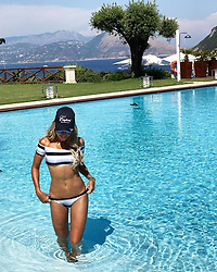 """Sylvie Meis releases a photo on Instagram with the following caption: """"\ud83d\udca6POOLDAY\ud83d\udca6#spotthecrocodile \ud83d\udc0a #Capri #amalficoast #lovefromitaly \u2764\ud83c\uddee\ud83c\uddf9 @jkcapri"""". Photo Credit: Instagram *** No USA Distribution *** For Editorial Use Only *** Not to be Published in Books or Photo Books ***  Please note: Fees charged by the agency are for the agency's services only, and do not, nor are they intended to, convey to the user any ownership of Copyright or License in the material. The agency does not claim any ownership including but not limited to Copyright or License in the attached material. By publishing this material you expressly agree to indemnify and to hold the agency and its directors, shareholders and employees harmless from any loss, claims, damages, demands, expenses (including legal fees), or any causes of action or allegation against the agency arising out of or connected in any way with publication of the material."""