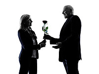 one caucasian couple senior lovers flower rose silhouette  in silhouette studio isolated on white background