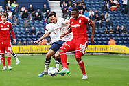 Kagisho Dikgacoi of Cardiff City holds off Greg Cunningham of Preston North End. Skybet football league championship match, Preston North End v Cardiff City at the Deepdale stadium in Preston, Lancashire on Saturday 17th October 2105.<br /> pic by Chris Stading, Andrew Orchard sports photography.