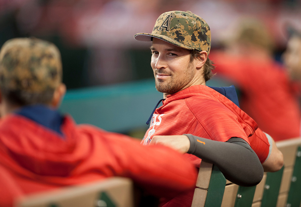 C.J. Wilson takes in the game form the bench after being shut down after pitching in a simulated game.