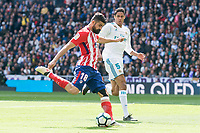 Real Madrid Raphael Varane and Atletico de Madrid Diego Costa during La Liga match between Real Madrid and Atletico de Madrid at Santiago Bernabeu Stadium in Madrid, Spain. April 08, 2018. (ALTERPHOTOS/Borja B.Hojas)