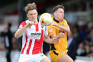 Rob Dickie of Cheltenham Town (l) challenges Mark Randall of Newport county.  EFL Skybet football league two match, Newport county v Cheltenham Town at Rodney Parade in Newport, South Wales on Saturday 10th September 2016.<br /> pic by Andrew Orchard, Andrew Orchard sports photography.