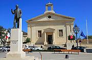 Stock Exchange building in former Garrison Chapel, Castille Square, Valletta, Malta statue of Prime Minister George Borg Olivier 1911-1980