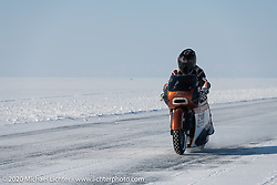 French custom bike builder Bertrand Dubet on his partially streamlined Aprilia RSV4 racer at the Baikal Mile Ice Speed Festival. Maksimiha, Siberia, Russia. Friday, February 28, 2020. Photography ©2020 Michael Lichter.
