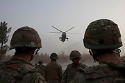 Mcc0027461 . Daily Telegraph..A Royal Navy Sea King helicopter landing at FOB Shahzad to pickup soldiers rotating back to Camp Bastion...Helmand 6 December 2010