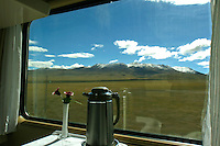 View out the Window of the Tibet Train - The Qinghai-Tibet Railway, the highest rail line in the world, is usually called the Tibet Train.  Its 1,200 miles of tracks traverse 342 miles of permafrost, lots of it at altitudes exceeding 12,000 feet. The end of the line is Lhasa, Tibet. Proponents of the new railway say it will bring economic development to the Tibet and China's hinterlands as Tibet and China's far west lag behind the rest of the country, and rail connectivity promises to be a crucial tool for closing that gap.  Critics say the railway is  a political tool to strategically stitch Tibet into the fabric of China and facilitate the westward migration of ethnic Chinese.  The only thing about the train that everyone agrees on,  the the Tibet  train is an engineering marvel.