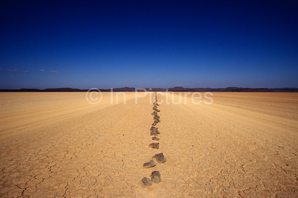Stones marking the Danakil desert road in Djibouti