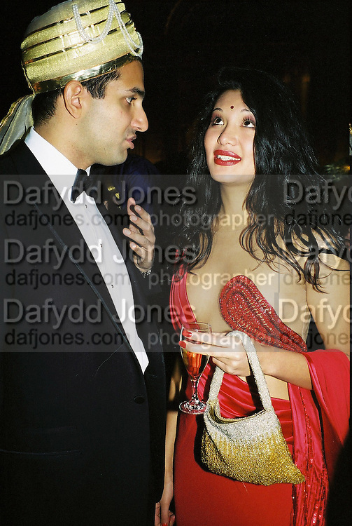 Dino Lalvani and Goga Berkalleva. Wong party. Old  Royal Naval College, Greenwich. 3/2/01. © Copyright Photograph by Dafydd Jones 66 Stockwell Park Rd. London SW9 0DA Tel 020 7733 0108 www.dafjones.com