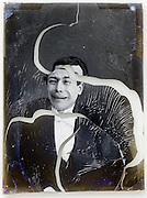 glass plate with broken emulsion of mime comedian portrait