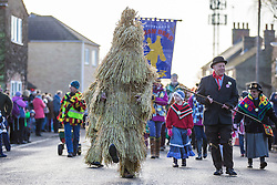 © Licensed to London News Pictures. 16/01/2016. Whittlesey UK. The 37th Straw Bear festival takes place this weekend in Whittlesey. It was the custom to dress one of the confraternity of the plough in straw & call him a Straw Bear, He was made to dance in front of houses & gifts of money or beer & food for later consumption was expected. The present Straw Bear dances through the streets accompanied by his handler & numerous dancers such as Pig Dyke Molly & The Bourne Borderers. Photo credit: Andrew McCaren/LNP