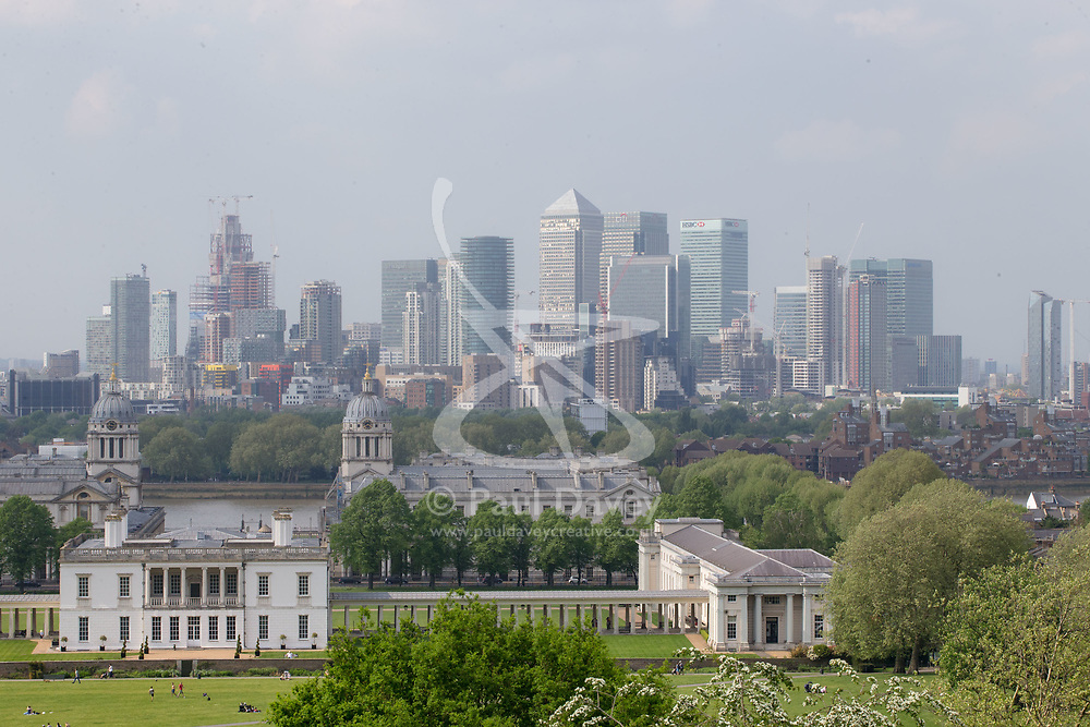 The hazy sunshine partially obscures the Docklands skyline in London, seen from Maze Hill, Greenwich as Mayor Sadiq Khan announces air toxicity alerts for the Capital. London, May 08 2018.